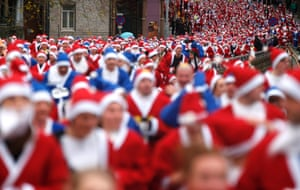 The annual Santa Dash in Liverpool attracts Everton supporters in blue suits