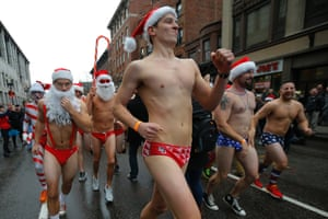 The 15th annual Santa Speedo Run, a charity run through the streets of the Back Bay, in Boston, Massachusetts