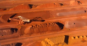 A bucket wheel reclaimer collects ore at the BHP Billiton iron ore loading facility in Port Hedland, about 1,600 km (994 miles) north of Perth