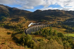 Autumn in the Glens - The Western Highlands are aglow with the burning hues of autumn, as the LMS Stainer class 5 steam locomotive hauls the Jacobite train over the Glenfinnan Viaduct - made famous on the Harry Potter film as the Hogwarts Express - where passengers pass through the breathtaking rust tinted Glens during a tranquil respite in the weather