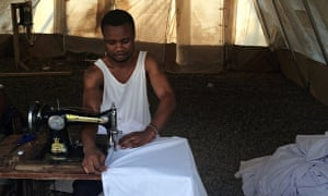 Sewing the ceiling of the MSF treatment centre in Freetown