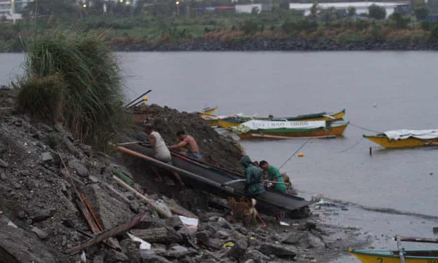 Fishermen dock their boats at Manila Bay as Typhoon Hagupit (locally known as Ruby) approaches on 7 December 2014, Pasay City, Philippines.