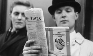 A posed photo of a man reading DH Lawrence's Lady Chatterley's Lover on the day the book went on general sale in 1960