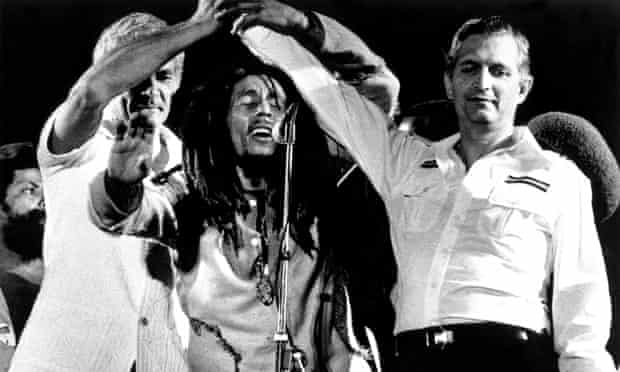 Bob Marley brings the Jamaican PM and opposition leader together on stage in a call of peace, at his