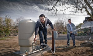 Daniel Arreola and his father Esidronio running the water from their new 110ft well after not having running water for over 6 months.
