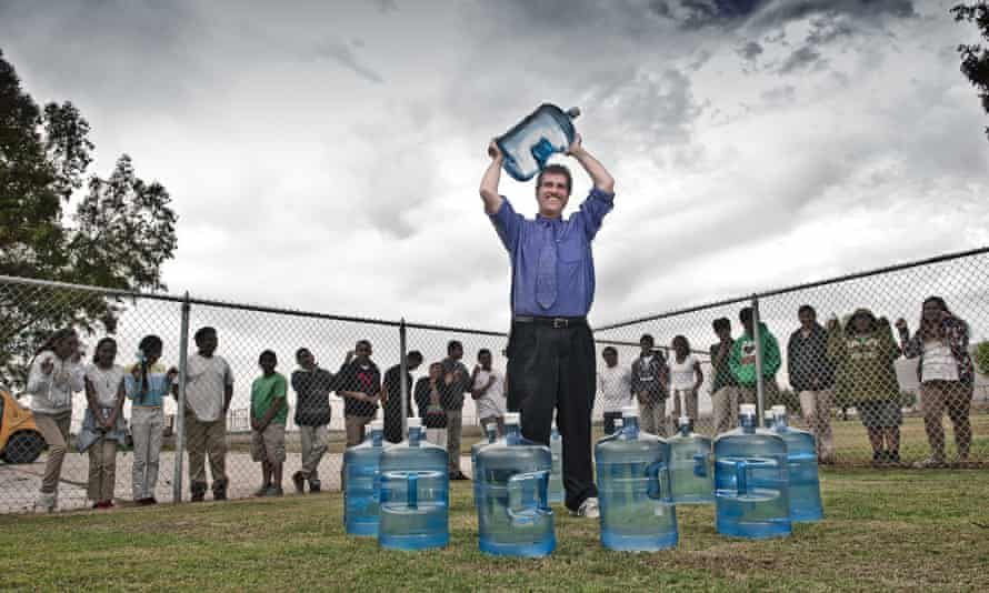 A lot of bottle: Chris Kemper, principal of the school in Seville, which has had to rely on delivered water.