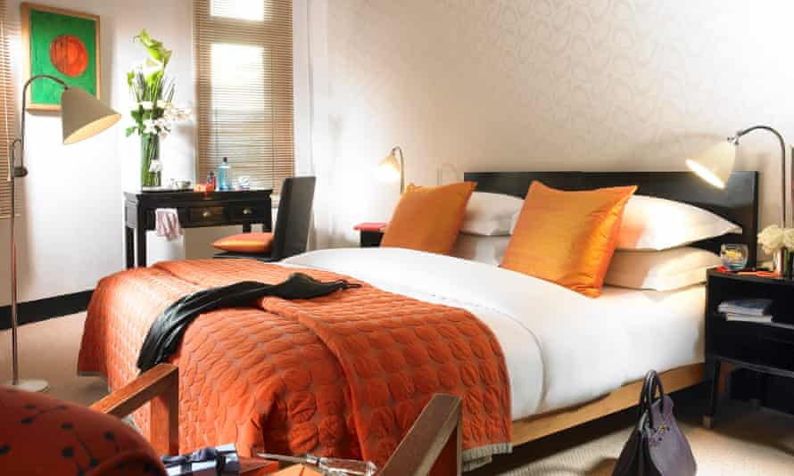 A bed in a Superior Room at MyHotel Bloomsbury