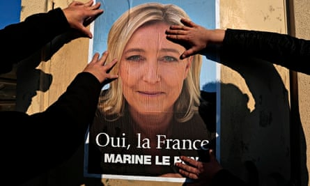 Suppporters put up a poster of Marine Le Pen