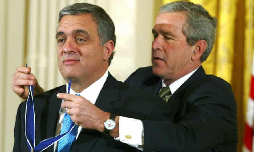 President George W.Bush presenting former CIA director George Tenet the Presidential Medal of Freedom Award, the nation's highest civilian honor