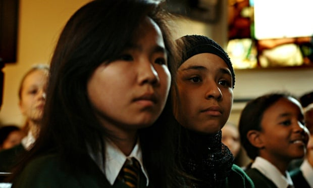 Pupils from St Marylebone school, London, attend a multi-faith assembly in church.