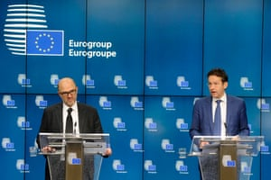 (L-R) European Commissioner for economics, taxation and customs Pierre Moscovici and Eurogroup president Jeroen Dijsselbloem attend a press conference after an Euro zone finance ministers meeting in Brussels December 8, 2014.