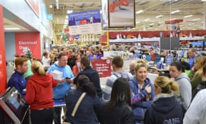 Shoppers queue at at a Tesco store in Lurgan, County Armagh, on Black Friday.