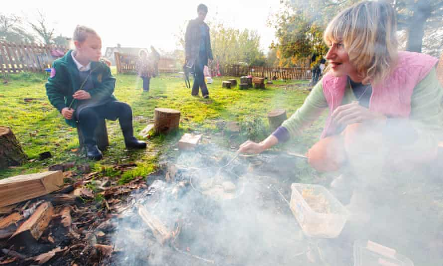 Emma Harwood and Tilly, 5, making Welsh cakes on an open fire at Dandelion forest school.