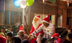 Santa comes to Bow Barracks on a hand-pulled rickshaw.