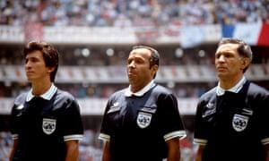 referee Ali Bin Nasser, centre, and linesman Bogdan Dotchev