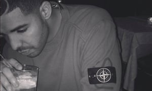 Drake wearing a sweater from the Supreme x Stone Island collaboration