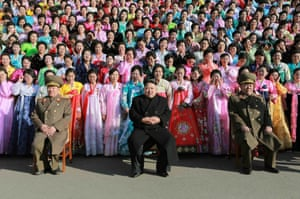North Korean leader Kim Jong-Un (C) joining a photo session with the participants in the second meeting of Korean People's Army (KPA) exemplary servicemen's families in Pyongyang.