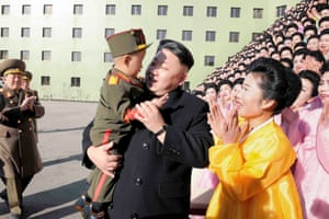 North Korean leader Kim Jong Un holds a boy after a photo session with participants in the Second Meeting of KPA Exemplary Servicemen's Families in Pyongyang.