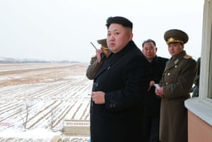 Kim Jong Un (front) inspecting the Korean People's Army (KPA) Air and Anti-Air Force Unit 458.