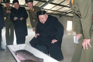 North Korean leader Kim Jong-Un (C) inspecting the May 9 Catfish Farm at an undisclosed location in North Korea.
