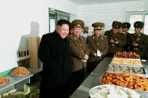 North Korean leader Kim Jong-un (L) smiling during his visit to an artillery unit at an undisclosed location, North Korea.