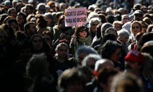 Thousands of people march to protest a a government plan to limit abortions in Madrid