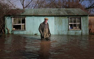 Leader of UKIP Nigel Farage wades in water as he visits a flooded property at Burrowbridge on the Somerset Levels near Bridgwater, England.
