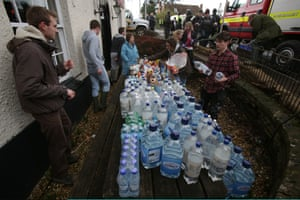Volunteers sort out donations in the King Alfred Inn at Burrowbridge on the Somerset Levels near Bridgwater, England.