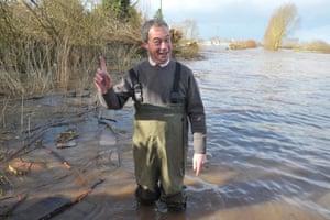 Ukip leader Nigel Farage looking at the floodwater in Burrowbridge, Somerset.