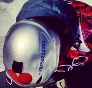 Alexey Sobolev makes an unusual plea for attention by wearing his mobile number on his helmet