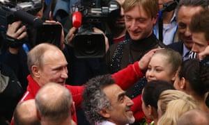 Russian President Vladimir Putin congratulates Yulia Lipnitskaya of Russia after the Team Figure Skating event on day 2 of the Sochi 2014 Winter Olympics
