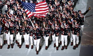 Nordic combined skier Todd Lodwick of the United States Olympic team carries his country's flag during the Opening Ceremony of the Sochi 2014 Winter Olympics