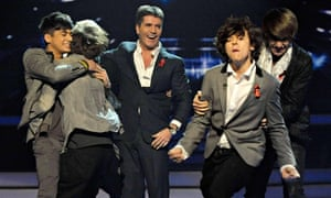 Simon Cowell with One Direction on The X Factor