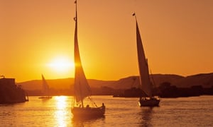 'Life-giving waters': feluccas at sunset on the Nile at Aswan.