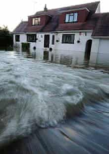 Floodwaters rush into a home in Wraysbury