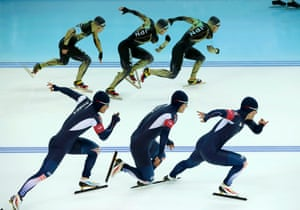 Joji Kato of Japan (top) and Mo Tae-bum of South Korea compete in race one of the men's 500 meters speed skating event during the 2014 Sochi Winter Olympics.  Picture taken using multiple exposure function.