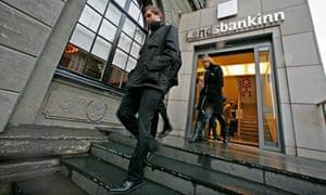 Customers leave Landsbanki branch