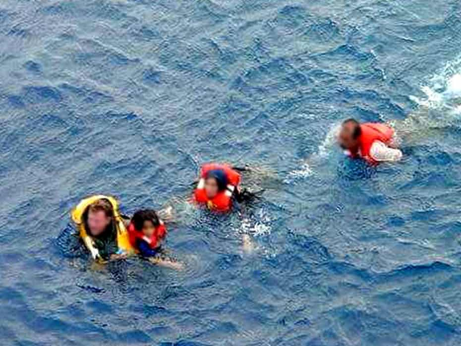 The pictures which purported to prove that asylum seekers attempting to reach Australia had thrown their children into the sea.