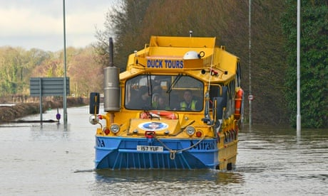 A duck boat was used on the Thames to rescue people after the river burst its banks.