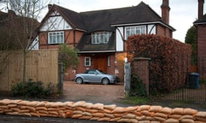 A sandbag wall in Datchet constructed by over a hundred Royal Navy engineers last night protects a house from flooding should the level of the River Thames continue to rise as expected.