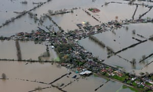 Flooded properties are seen as water surrounds the village of Moorland on the Somerset Levels on February 10, 2014 in Somerset, England