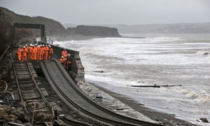 Railway workers inspect the main Exeter to Plymouth  railway line at Dawlish