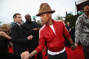 Pharrell Williams and Helen Lasichanh attend the 56th GRAMMY Awards at Staples Center on January 26, 2014 in Los Angeles, California.