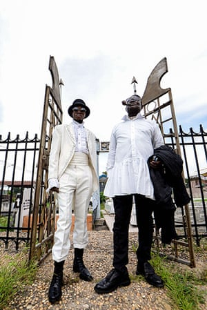 FTA: La Sape: Mwetu (L) and Mozar, two Sapeurs, pose as arrive at the Gombe cemetery in K