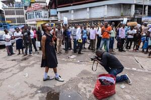 FTA: La Sape: Mzee Kindingu poses for a photographer in Kinshasa