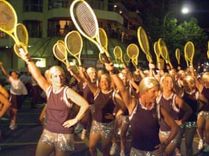 Women dressed as French tennis star Amelie Mauresmo march in the Mardi Gras parade through  Sydney.