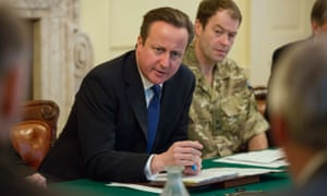 David Cameron speaks during a Cobra meeting at Number 10 Downing Street as the Met Office issued a rare red warning for exceptionally strong winds.