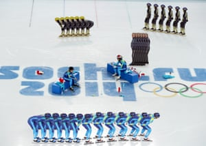 Short track speed skaters from Kazakhstan (blue) and Japan warming up at the Iceberg Skating Palace.