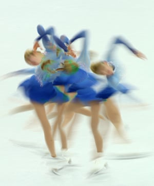 A multiple exposure picture shot using a slow-shutter speed of Gracie Gold of the USA performing in the women's Free Skating.