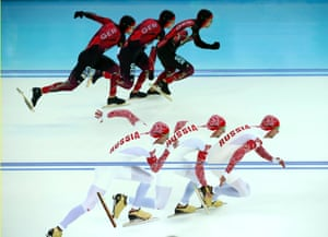 Samuel Schwarz of Germany (top) and Aleksey Yesin of Russia compete in race one of the men's 500 meters speed skating event.